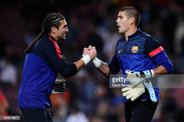 Jose Manuel Pinto of FC Barcelona and his teammate Victor Valdes shake hands during the warm up prior to the UEFA Champions League Group G match...