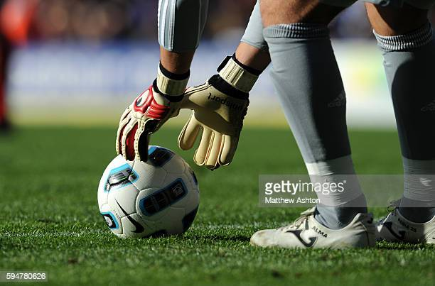 Jose Manuel Reina of Liverpool places the Nike ball down wearing goalkeeper gloves before a free kick