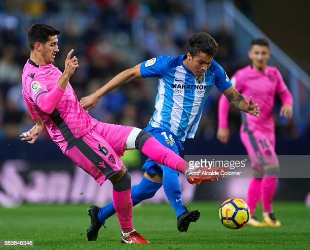 Jose Manuel Rodriguez 'Chema' of Levante UD competes for the ball with Adalberto Penaranda of Malaga CF during the La Liga match between Malaga and...