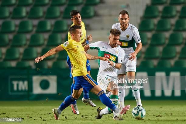Jose Manuel Sanchez Guillen of Elche CF competes for the ball with Salvi Sanchez of Cadiz CF during the La Liga Smartbank match between Elche CF and...