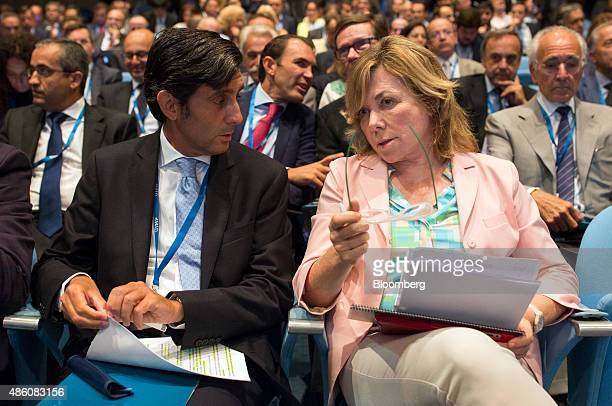 Jose Maria AlvarezPallete chief operating officer of Telefonica SA speaks to Pilar del Castillo a member of the European parliament at the opening...
