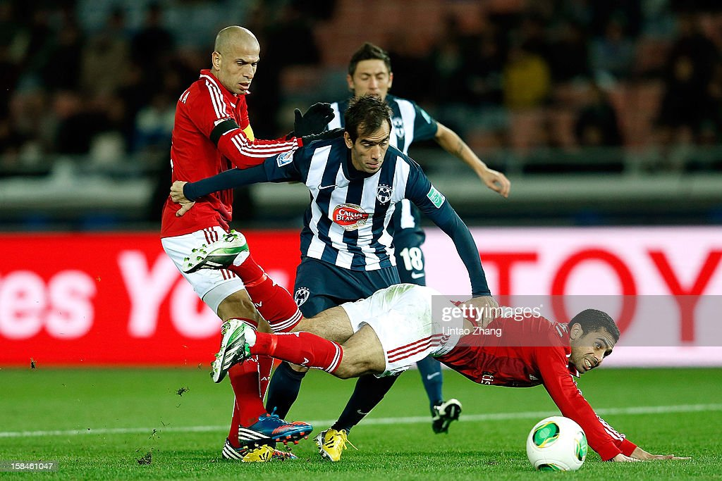 Jose Maria Basanta (C) of CF Monterrey challenges Wael Gomaa (L) and Ahmed Fathi during the FIFA Club World Cup 3rd Place Match between Al-Ahly SC and CF Monterrey at International Stadium Yokohama on December 16, 2012 in Yokohama, Japan.