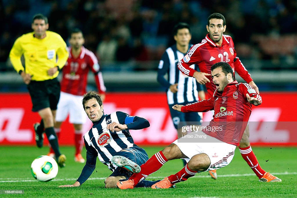 Jose Maria Basanta (R) of Monterrey challenges Emad Meteab of Al-Ahly SC during the FIFA Club World Cup 3rd Place Match between Al-Ahly SC and CF Monterrey at International Stadium Yokohama on December 16, 2012 in Yokohama, Japan.