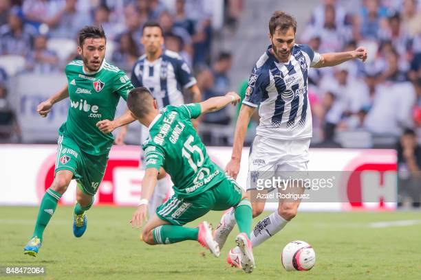 Jose Maria Basanta of Monterrey fights for the ball with Bryan Garnica of Atlas during the 9th round match between Monterrey and Atlas as part of the...