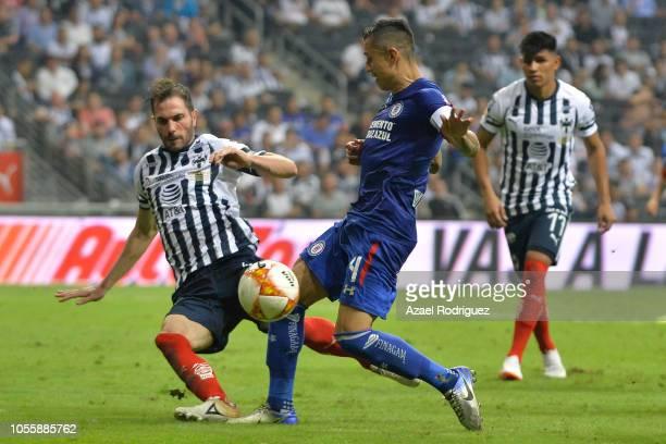Jose Maria Basanta of Monterrey fights for the ball with Julio Dominguez of Cruz Azulduring the Final match between Monterrey and Cruz Azul as part...