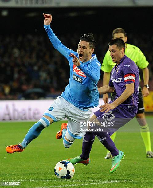 Jose Maria Callejon of Napoli and Mauel Pasqual of Fiorentina in action during the Serie A match between SSC Napoli and ACF Fiorentina at Stadio San...