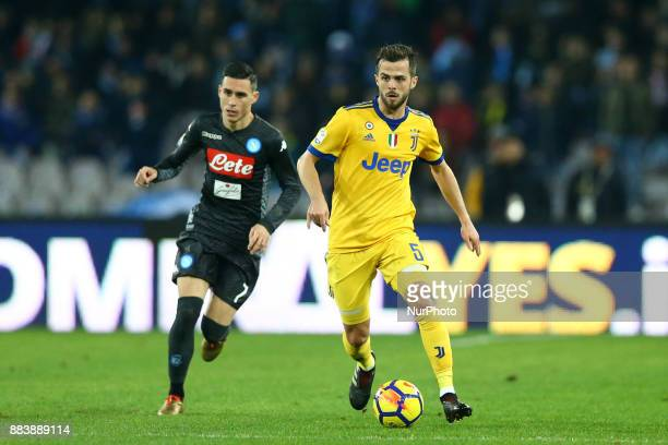 Jose Maria Callejon of Napoli and Miralem Pjanic of Juventus during the Serie A match between SSC Napoli and Juventus at Stadio San Paolo on December...