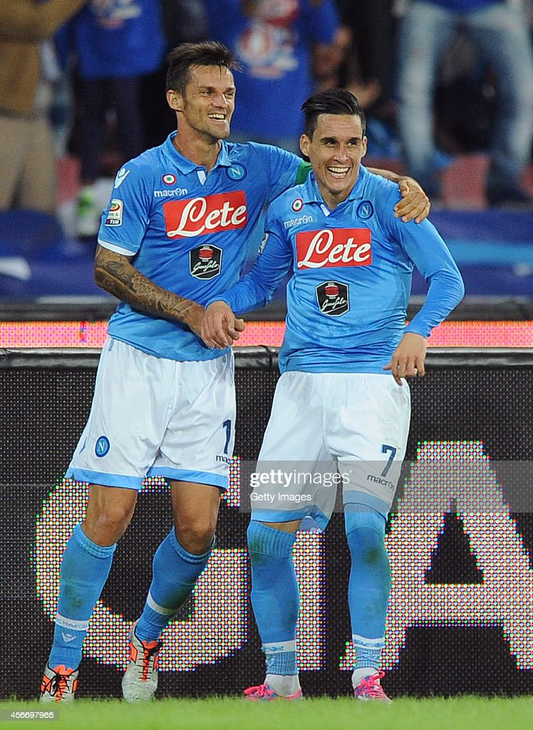 Jose Maria Callejon (R) of Napoli celebrates his goal 2-1 with team mate Christian Maggio during the Serie A match between SSC Napoli and Torino at San Paolo Stadium on October 5, 2014 in Naples, Italy.