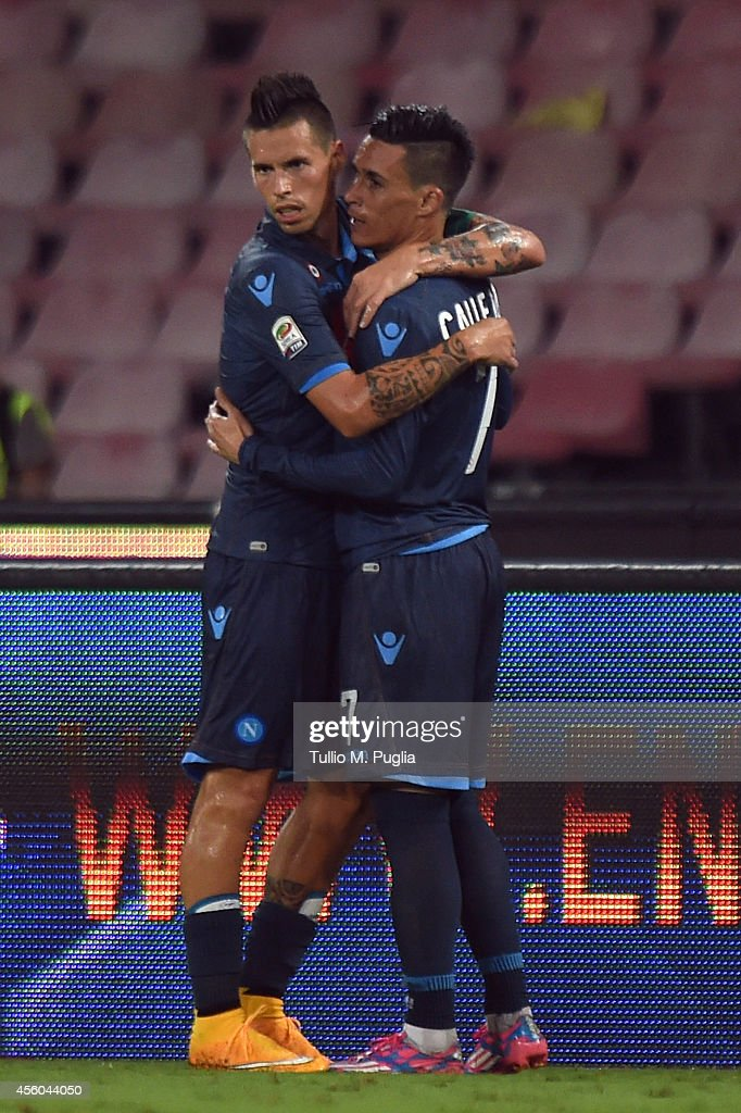 Jose Maria Callejon (R) of Napoli celebrates with his team mates Marek Hamsik after scoring his team's third goal during the Serie A match between SSC Napoli and US Citta di Palermo at Stadio San Paolo on September 24, 2014 in Naples, Italy.