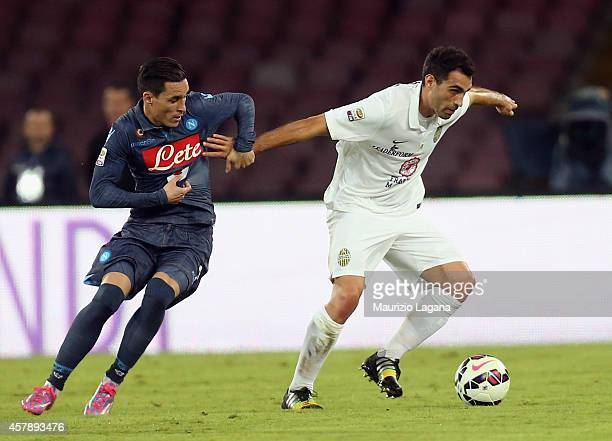 Jose' Maria Callejon of Napoli competes for the ball with Davide Brivio of Verona during the Serie A match between SSC Napoli and Hellas Verona FC at...