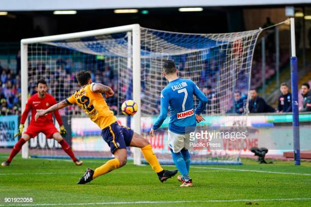 Jose Maria Callejon of SSC Napoli and Antonio Caracciolo and Nicolas Andrade of Hellas Verona fights for the ball during the Serie A TIM match...