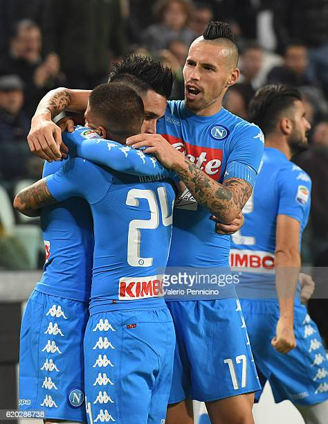 Jose Maria Callejon of SSC Napoli celebrates a goal with team mates Lorenzo Insigne and Marek Hamsik during the Serie A match between Juventus FC and...
