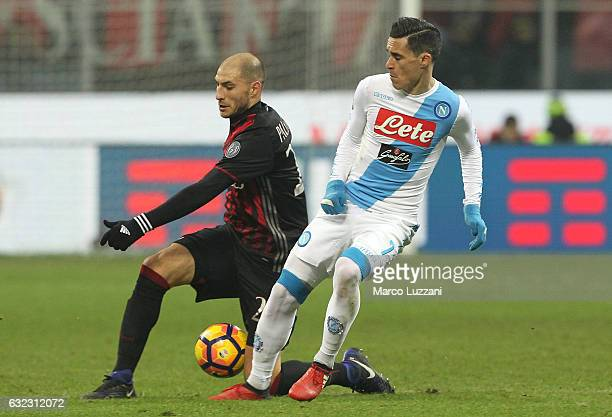 Jose Maria Callejon of SSC Napoli competes for the ball with Gabriel Paletta of AC Milan during the Serie A match between AC Milan and SSC Napoli at...