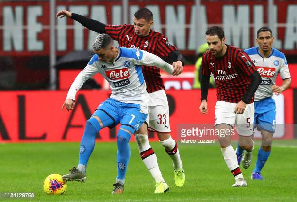 Jose Maria Callejon of SSC Napoli competes for the ball with Rade Krunic of AC Milan during the Serie A match between AC Milan and SSC Napoli at...