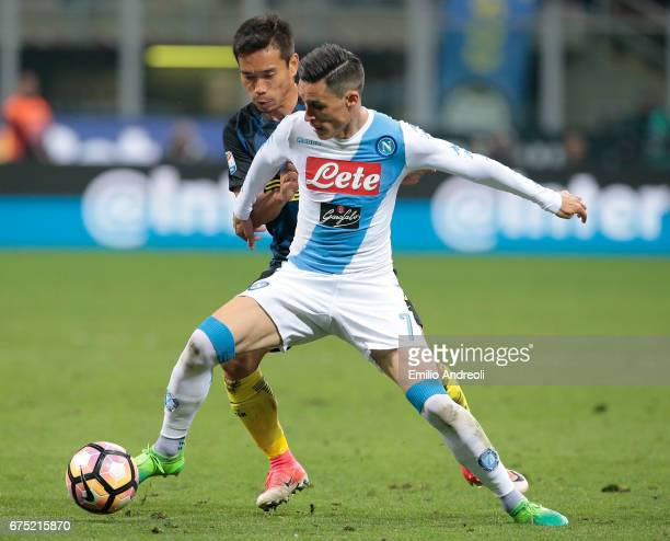 Jose Maria Callejon of SSC Napoli competes for the ball with Yuto Nagatomo of FC Internazionale Milano during the Serie A match between FC...