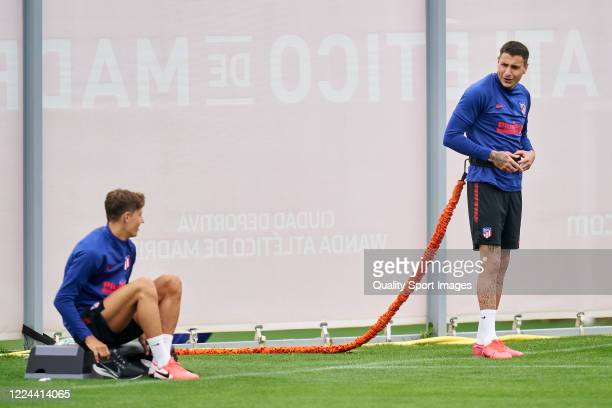 Jose Maria Gimenez and Marcos Llorente of Atletico de Madrid speaking during a training session at Estadio Cerro del Espino on May 12 2020 in Madrid...