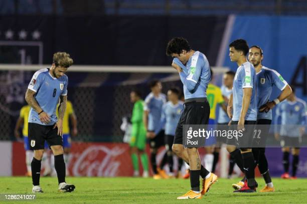 Jose Maria Gimenez, Nahitan Nandez Agustin Oliveros and Martin Caceres of Uruguay lament after a match between Uruguay and Brazil as part of South...