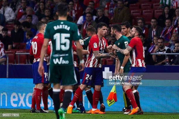 Jose Maria Gimenez of Atletico de Madrid argues with Jordi Amat of Real Betis Balompie during the La Liga match between Club Atletico Madrid and Real...