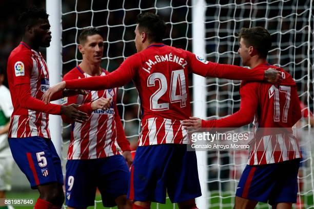 Jose Maria Gimenez of Atletico de Madrid celebrates scoring their opening goal with teammates Thomas Teye Partey Fernando Torres and Luciano Vietto...