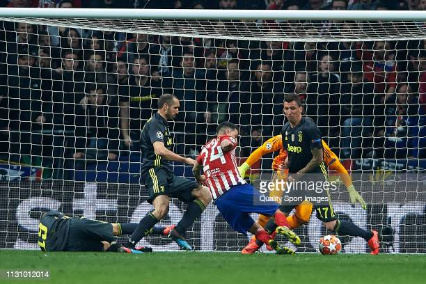 Jose Maria Gimenez of Atletico de Madrid kicks the ball to score during the UEFA Champions League Round of 16 First Leg match between Club Atletico...
