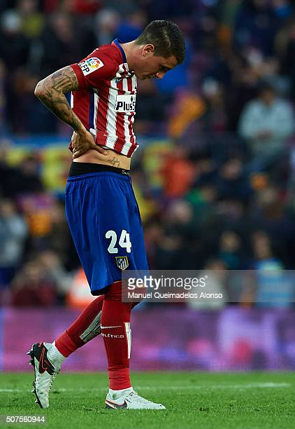 Jose Maria Gimenez of Atletico de Madrid leaves the pitch at the end of the La Liga match between FC Barcelona and Atletico de Madrid at Camp Nou on...