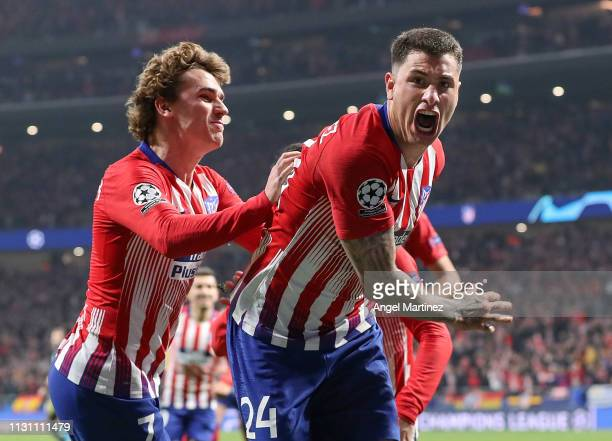 Jose Maria Gimenez of Atletico Madrid celebrates with Antoine Griezmann after scoring their team's first goal during the UEFA Champions League Round...