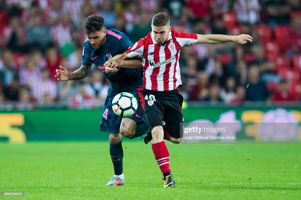 Jose Maria Gimenez of Atletico Madrid competes for the ball with Iker Muniain of Athletic Club during the La Liga match between Athletic Club and Atletico Madrid at San Mames Stadium on September 20, 2017 in Bilbao, Spain.
