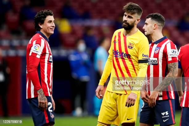 Jose Maria Gimenez of Atletico Madrid Gerard Pique of FC Barcelona Mario Hermoso of Atletico Madrid during the La Liga Santander match between...