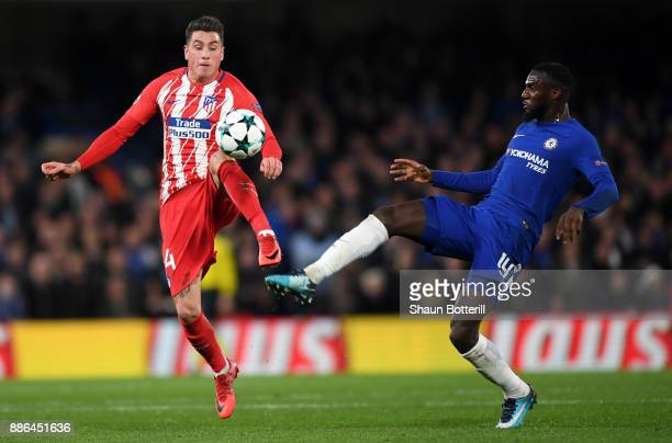 Jose Maria Gimenez of Atletico Madrid is challenged by Tiemoue Bakayoko of Chelsea during the UEFA Champions League group C match between Chelsea FC...