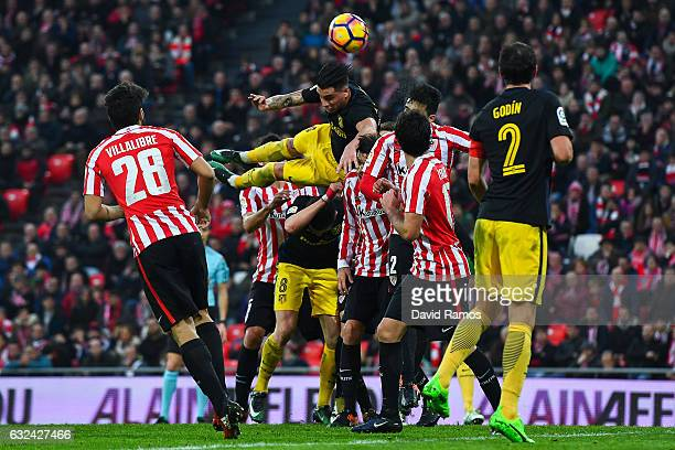 Jose Maria Gimenez of Club Atletico de Madrid competes for a high ball with Athletic Club players during the La Liga match between Athletic Club and...