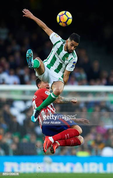Jose Maria Gimenez of Club Atletico de Madrid competes for the ball with Ryad Boudebouz of Real Betis Balompie during the La Liga match between Real...