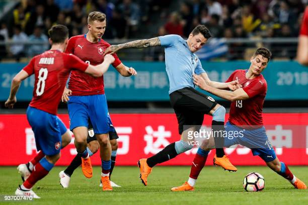 Jose Maria Gimenez of Uruguay and Patrik Schick of Czech Republic compete for the ball during the 2018 China Cup International Football Championship...