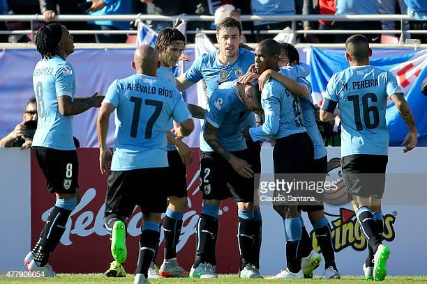 Jose Maria Gimenez of Uruguay celebrates with teammates after scoring the opening goal during the 2015 Copa America Chile Group B match between...