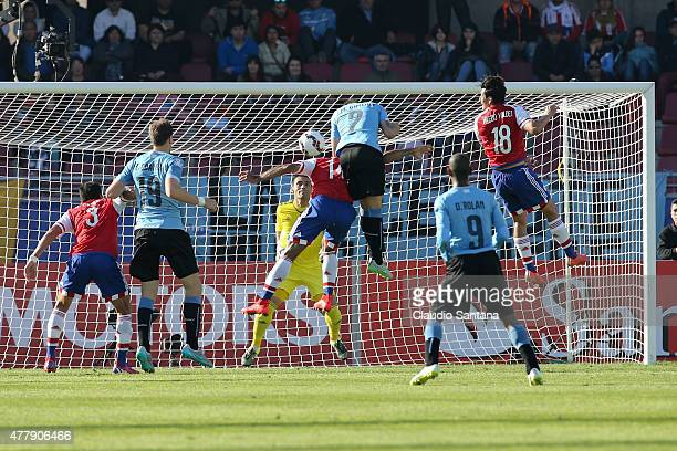 Jose Maria Gimenez of Uruguay heads to score the opening goal during the 2015 Copa America Chile Group B match between Uruguay and Paraguay at La...