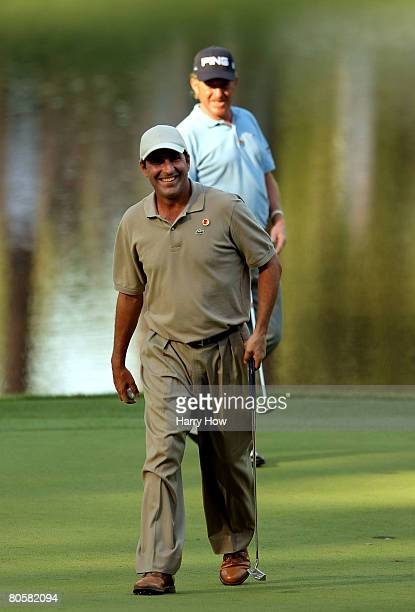 Jose Maria Olazabal and Miguel Angel Jimenez walk across the green during the Par 3 Contest prior to the start of the 2008 Masters Tournament at...