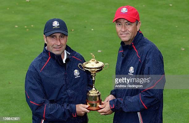 Jose Maria Olazabal captain of the European team and Davis Love III captain of the USA team pose for a photograph with the Ryder Cup trophy prior to...
