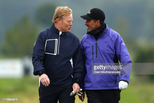 Jose Maria Olazabal of Spain speaks to Manager of the Netherlands national team Ronald Koeman as they play in the ProAm during the KLM Open at The...