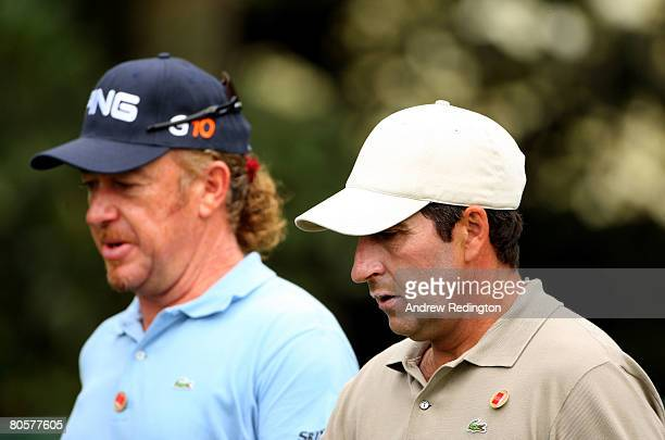 Jose Maria Olazabal of Spain walks with Miguel Angel Jimenez of Spain during the third day of practice prior to the start of the 2008 Masters...