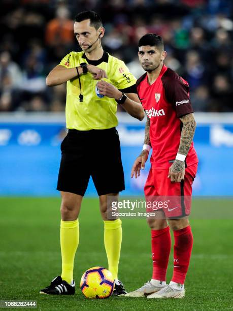 Jose Maria Sanchez Martinez referee Ever Banega of Sevilla FC during the La Liga Santander match between Deportivo Alaves v Sevilla at the Estadio de...