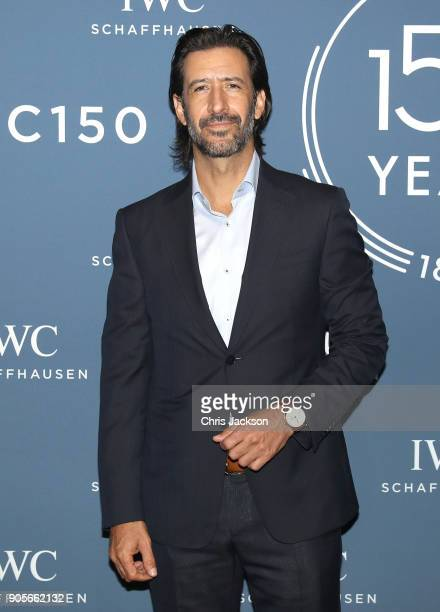 Jose Maria Yazpik visits the IWC booth during the Maison's launch of its Jubilee Collection at the Salon International de la Haute Horlogerie on...