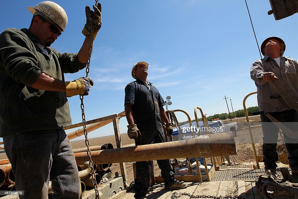 Jose Marquez, Israel Garcia and John Hicks with Arthur & Orum Well Drilling prepare to install a new drill pipe on a rig while drilling a well at a farm on April 29, 2014 near Mendota, California. As the California drought continues, Central California farmers are hiring well drillers to seek water underground for their crops after the U.S. Bureau of Reclamation stopped providing Central Valley farmers with any water from the federally run system of reservoirs and canals fed by mountain runoff.