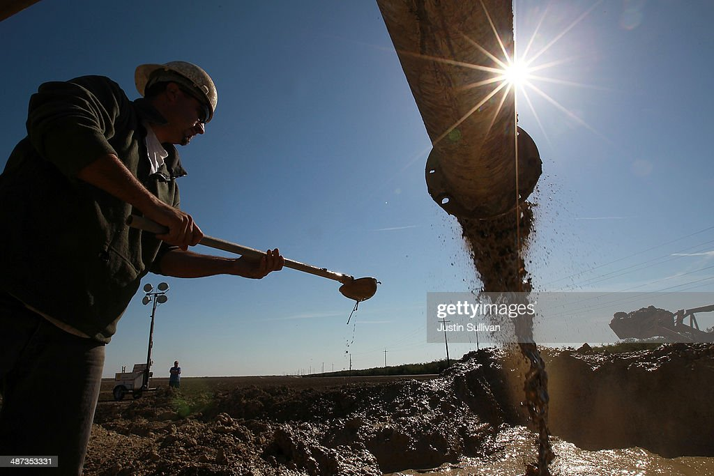 Jose Marquez with Arthur & Orum Well Drilling checks muddy water as it is discharged from a well drilling rig on April 29, 2014 near Mendota, California. As the California drought continues, Central California farmers are hiring well drillers to seek water underground for their crops after the U.S. Bureau of Reclamation stopped providing Central Valley farmers with any water from the federally run system of reservoirs and canals fed by mountain runoff.