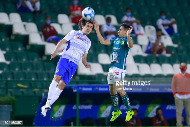 Jose Martinez of Cruz Azul fights for the ball with Fernando Navarro of Leon during the 8th round match between Leon and Cruz Azul as part of the...