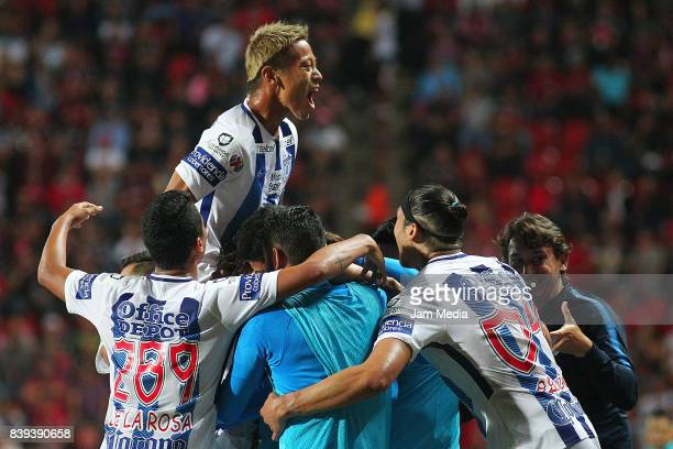 Jose Martinez of Pachuca celebrates with teammates after scoring the first goal of his team during the seventh round match between Tijuana and...