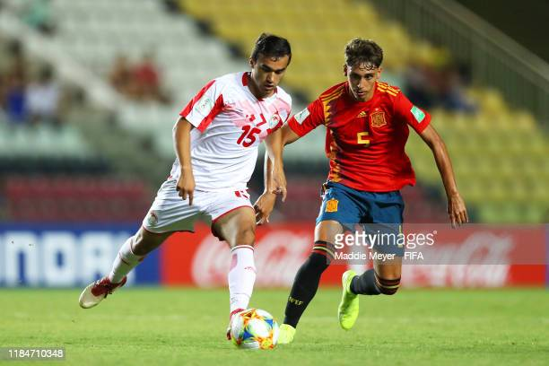 Jose Martinez of Spain defends Sunatullo Ismoilov of Tajikistan during the FIFA U17 World Cup Brazil 2019 group E match between Spain and Tajikistan...