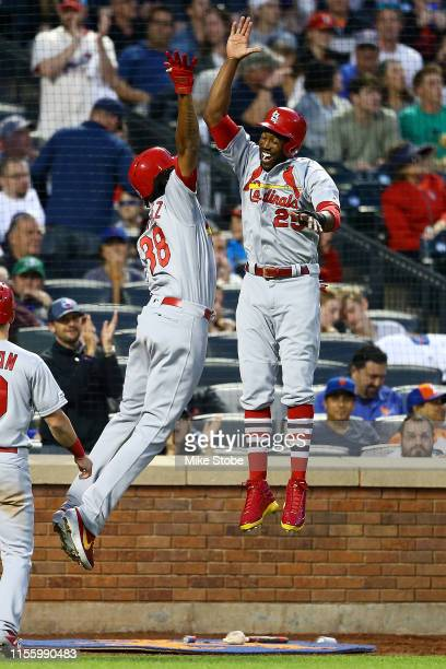 Jose Martinez of the St Louis Cardinals celbrates with Dexter Fowler after hitting a threerun home run to right field in the fifth inning against the...