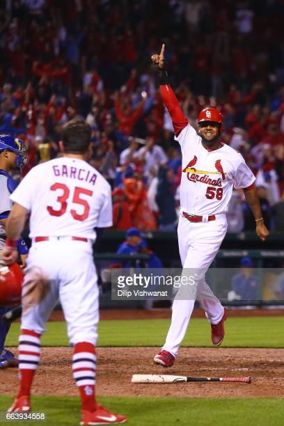 Jose Martinez of the St Louis Cardinals celebrates a after scoring the gamewinning run against the Chicago Cubs in the ninth inning during the 2017...