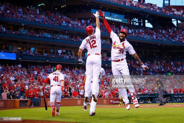 Jose Martinez of the St Louis Cardinals celebrates after hitting a tworun home run against the Pittsburgh Pirates in the first inning at Busch...