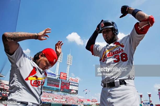 Jose Martinez of the St Louis Cardinals celebrates with Carlos Martinez after hitting a solo home run in the first inning against the Cincinnati Reds...