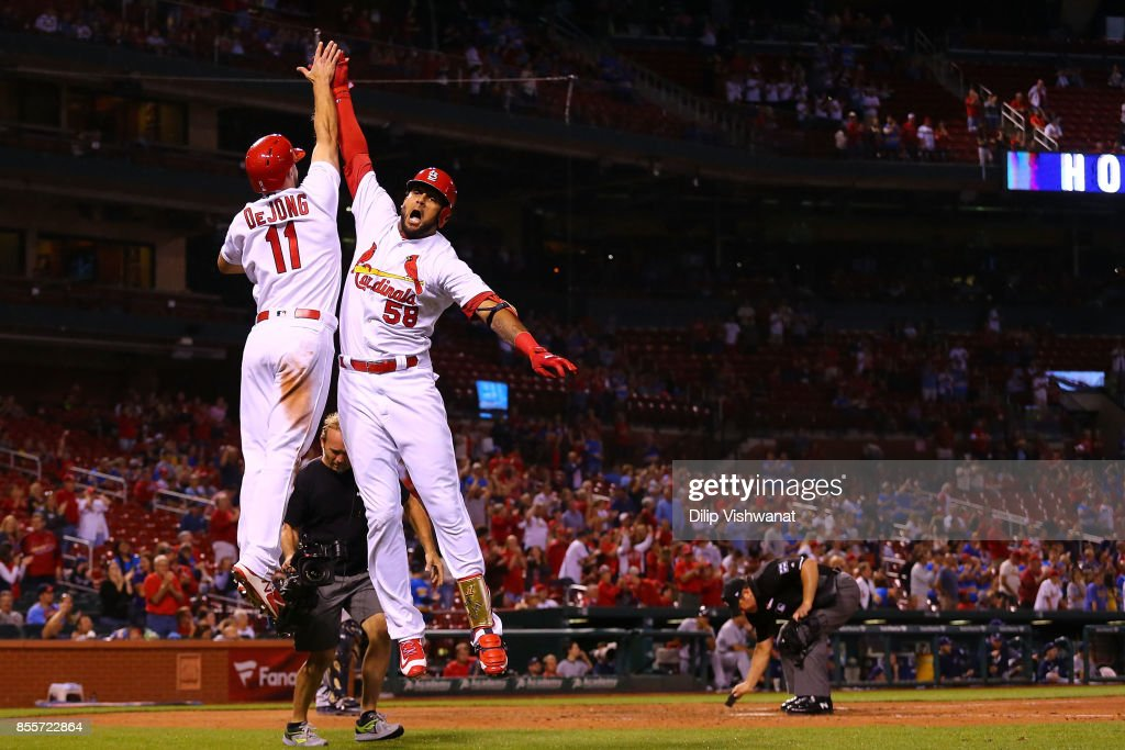 Jose Martinez #58 of the St. Louis Cardinals celebrates with Paul DeJong #11 after hitting a two-run home run against the Milwaukee Brewers in the ninth inning at Busch Stadium on September 29, 2017 in St. Louis, Missouri.